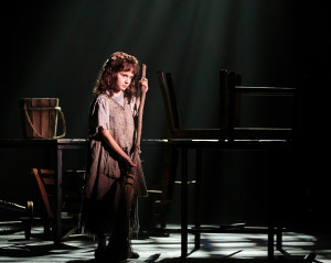 Victoria Ames as Little Cosette. Les Misérables production photo. © 2013 Mark Kitaoka. Property of Village Theatre.